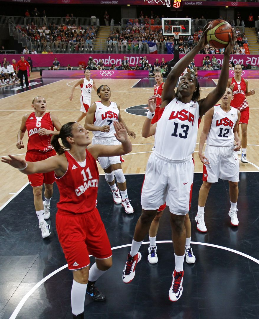 United States' Sylvia Fowles (13) grabs a rebound over Croatia's Ana Lelas (11) during their women's group A basketball game at the 2012 Summer Olympics on Saturday, July 28, 2012, in London. (AP Photo/Sergio Perez, Pool)