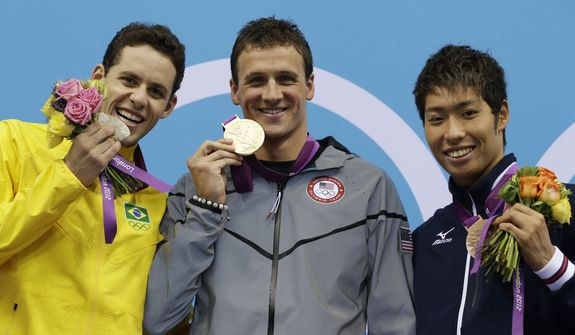Brazil's Thiago Pereira, left, United States' Ryan Lochte, center, and Japan's Kosuke Hagino pose with their medals for the men's 400-meter individual medley swimming final at the Aquatics Centre in the Olympic Park during the 2012 Summer Olympics in London, Saturday, July 28, 2012. Lochte won gold, Pereira silver and Kosuke bronze. (AP Photo/Michael Sohn)