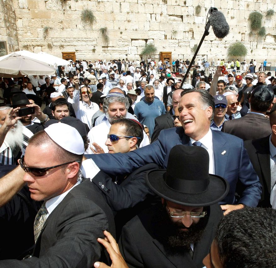 """GOP presidential hopeful Mitt Romney visits the Western Wall in Jerusalem. """"We must lead the effort to prevent Iran from building and possessing nuclear weapons capability,"""" he said. (Associated Press)"""