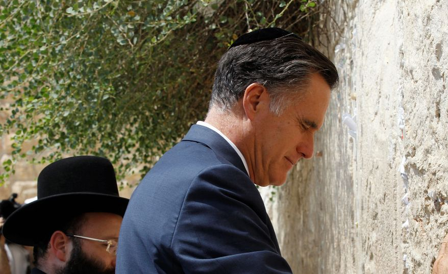 Republican presidential candidate Mitt Romney pauses as he visits the Western Wall in Jerusalem on Sunday. Mr. Romney received a warm welcome from the crowd gathered to hear him speak at the Jerusalem Foundation on Sunday, including many big campaign donors who flew in from the United States to Israel for the speech. (Associated Press)
