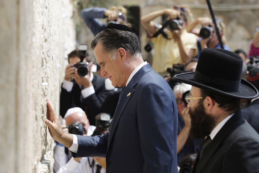 Republican presidential candidate Mitt Romney pauses July 29, 2012, next to the Western Wall in Jerusalem. (Associated Press)