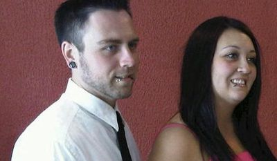 This undated photo provided by the family shows Matt McQuinn (left) and Samantha Yowler. McQuinn was killed and Yowler was wounded in the movie theater shootings July 20, 2012, in Aurora, Colo. (Associated Press)