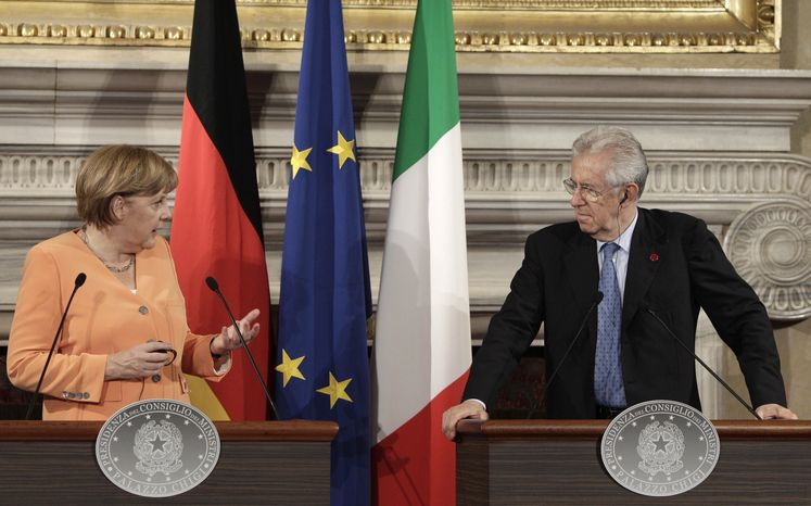 **FILE** German Chancellor Angela Merkel (left) and Italian Premier Mario Monti speak July 4, 2012, at a press conference during a bilateral meeting at Villa Madama in Rome. (Associated Press)