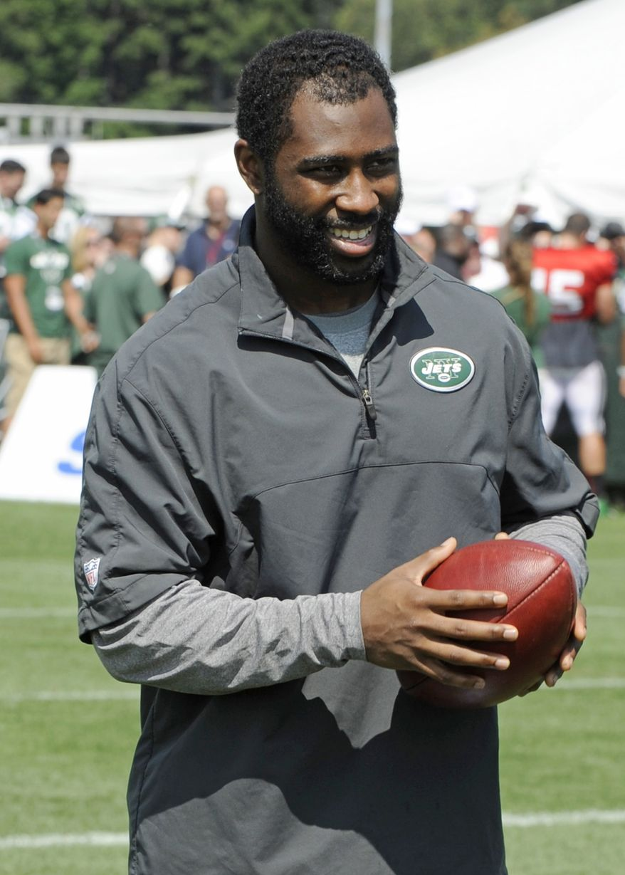 New York Jets cornerback Darrelle Revis walks off the field after practice at NFL football training camp on Sunday, July 29, 2012, in Cortland, N.Y. (AP Photo/Bill Kostroun)