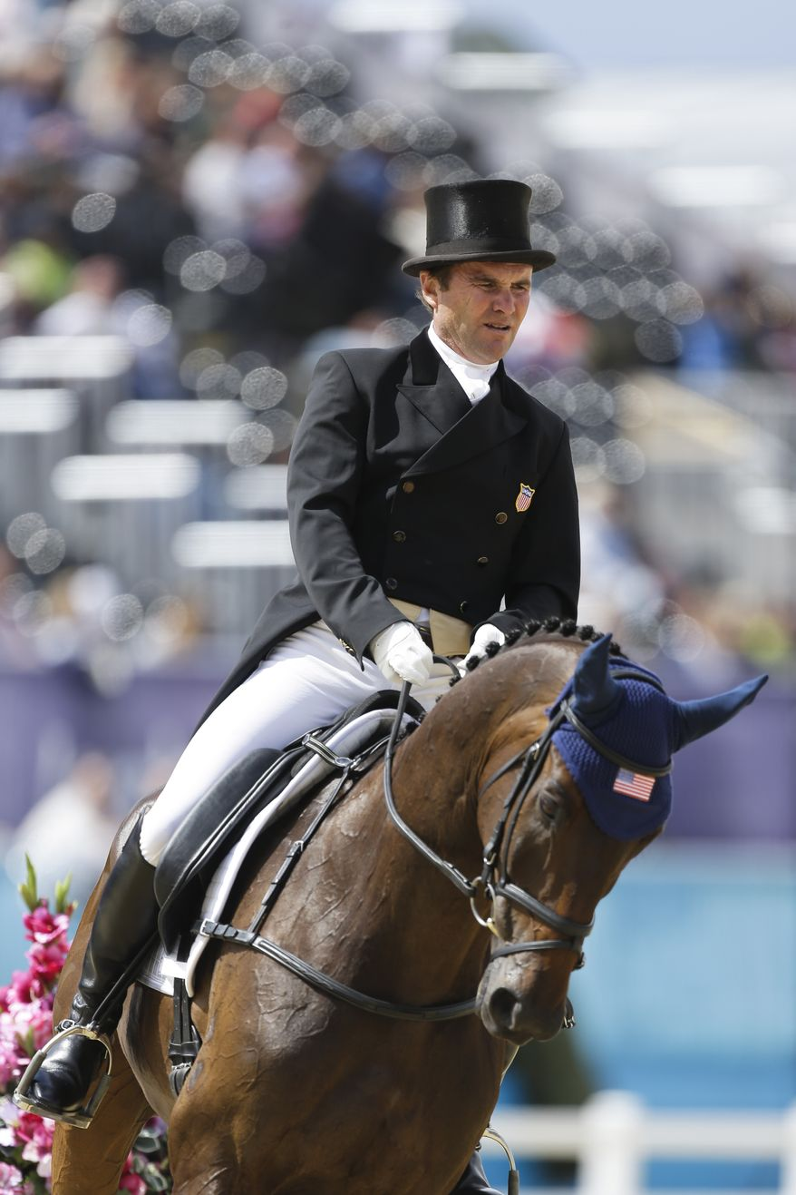 Phillip Dutton from the United States competes with his horse Mystery Whisper in the equestrian eventing dressage phase during the equestrian eventing competition at Greenwich Park, at the 2012 Summer Olympics, Sunday, July 29, 2012, in London. (AP Photo/Markus Schreiber)