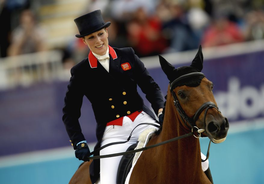 Zara Phillips, of Great Britain, and her horse High Kingdom, exit the ring after competing in the equestrian eventing dressage phase at the 2012 Summer Olympics, Sunday, July 29, 2012, in London. (AP Photo/David Goldman)