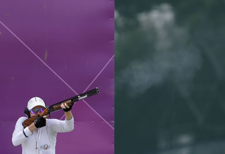 Slovakia's Danka Bartekova shoots during the women's skeet final at the 2012 Summer Olympics, Sunday, July 29, 2012, in London. Bartekova won a shoot out to secure the bronze medal.(AP Photo/Rebecca Blackwell)