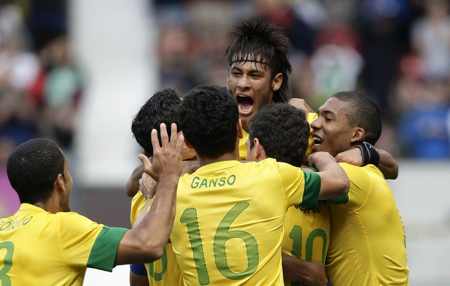 Brazil's Neymar, top, celebrates with teammates after scoring against Belarus during their group C men's soccer match at the London 2012 Summer Olympics, Sunday, July 29, 2012, at Old Trafford Stadium in Manchester, England. (AP Photo/Jon Super)