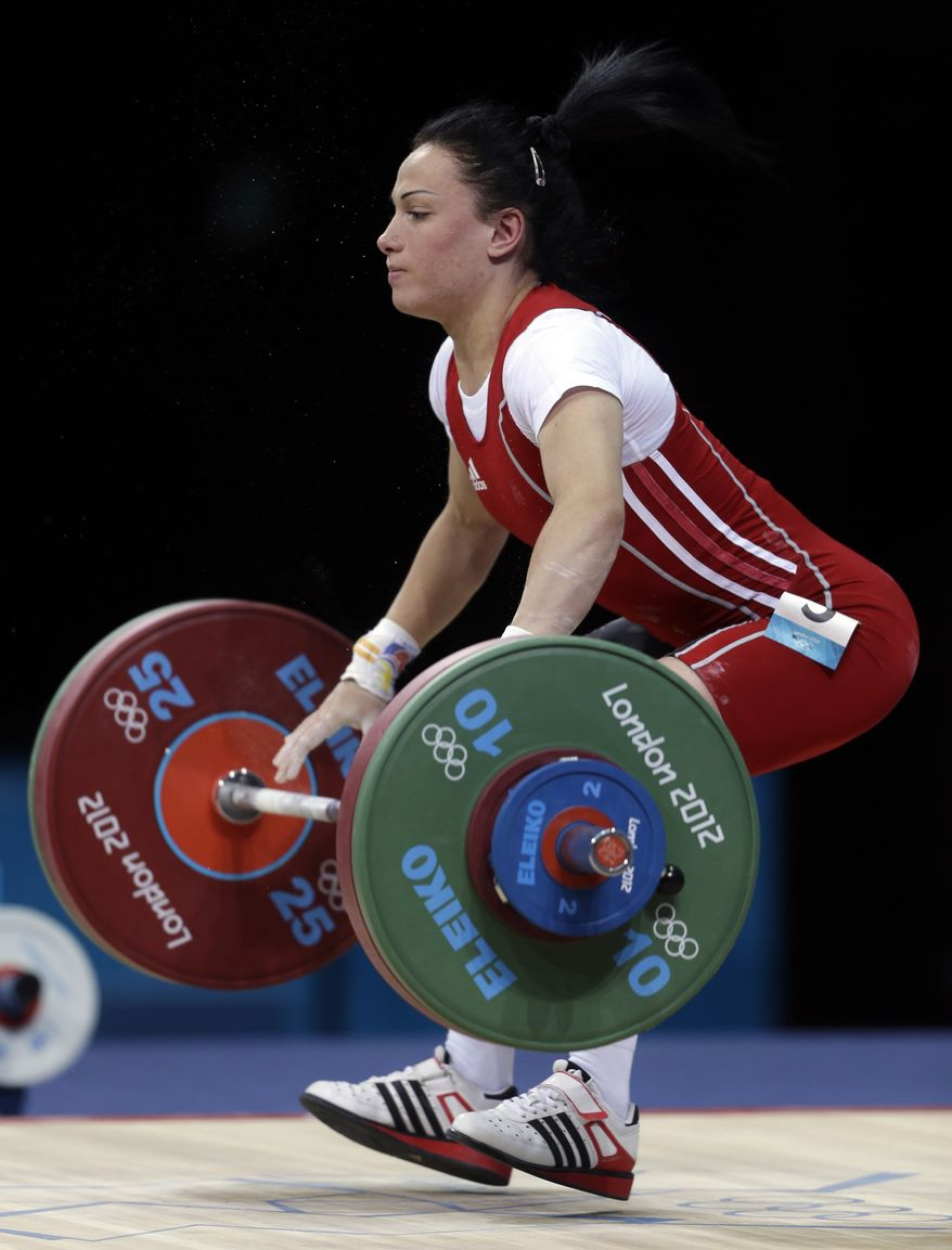 Moldova's Cristina Iovu lifts during the women's 53-kg, group A, weightlifting competition at the 2012 Summer Olympics, Sunday, July 29, 2012, in London. (AP Photo/Mike Groll)