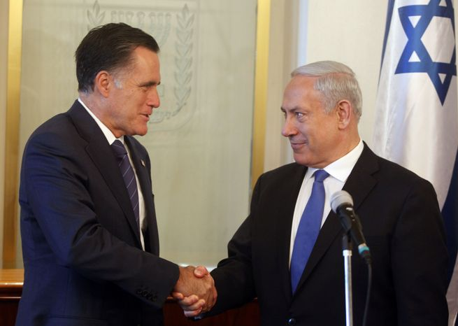 Israeli Prime Minister Benjamin Netanyahu (right) and Republican presidential candidate Mitt Romney shake hands July 29, 2012, at Netanyahu's office in Jerusalem. (Associated Press)