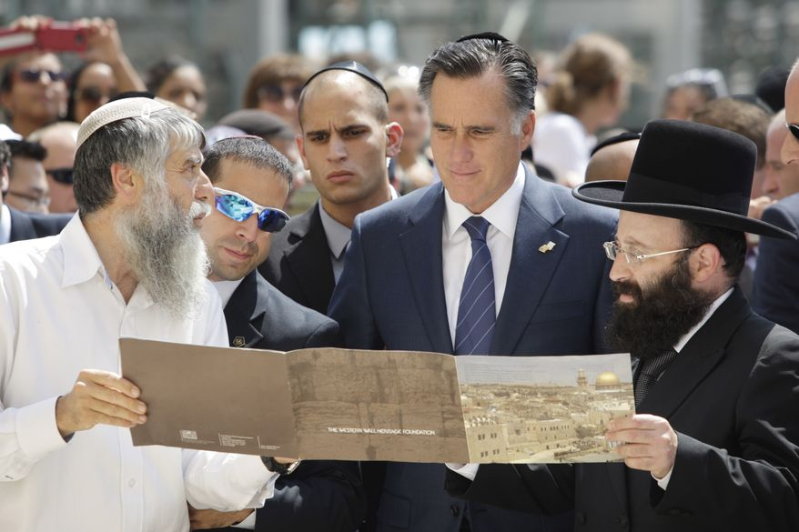 Republican presidential candidate Mitt Romney is presented July 29, 2012, with a booklet as he visits the Western Wall in Jerusalem. (Associated Press)