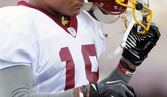 NFL Washington Redskin wide receiver Dezmon Briscoe takes a break at a practice during training camp at Redskins Park in Ashburn, Va., Saturday, July 28, 2012. The Redskins acquired Briscoe Friday, July 27 after he was waived by the Tampa Bay Buccaneers. (AP Photo/Cliff Owen)