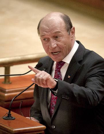 **FILE** Romanian President Traian Basescu addresses the country's parliament July 6, 2012, prior to a vote to impeach him in Bucharest, Romania. (Associated Press)