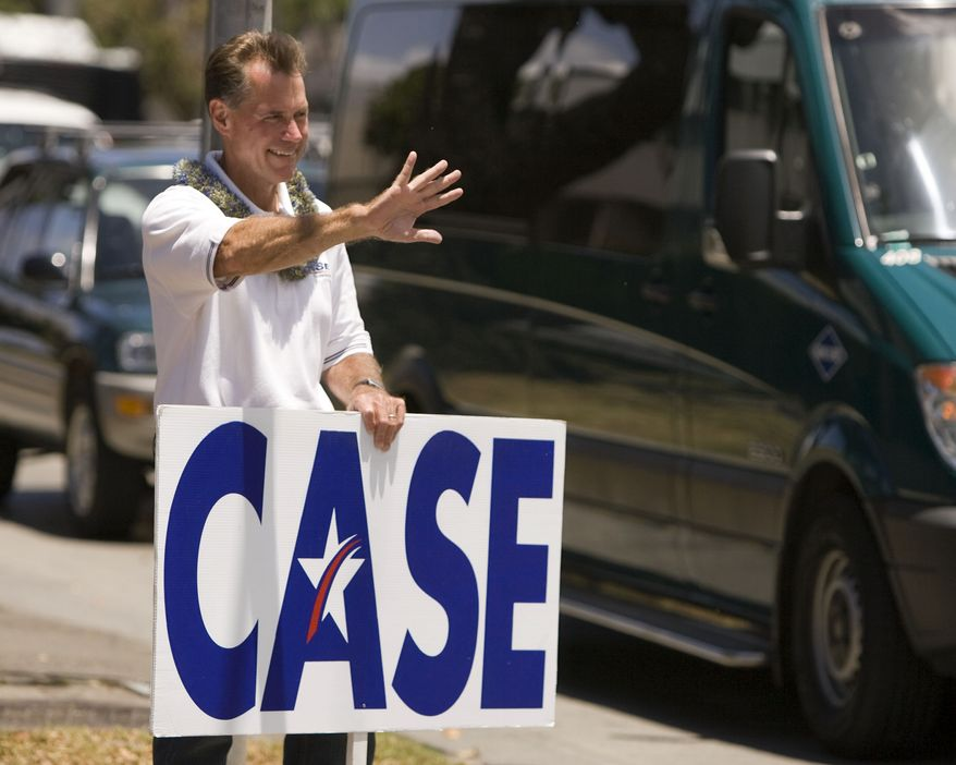 **FILE** Former Hawaii Rep. Ed Case holds a sign May 22, 2010, as he campaigns in Honolulu. (Associated Press)