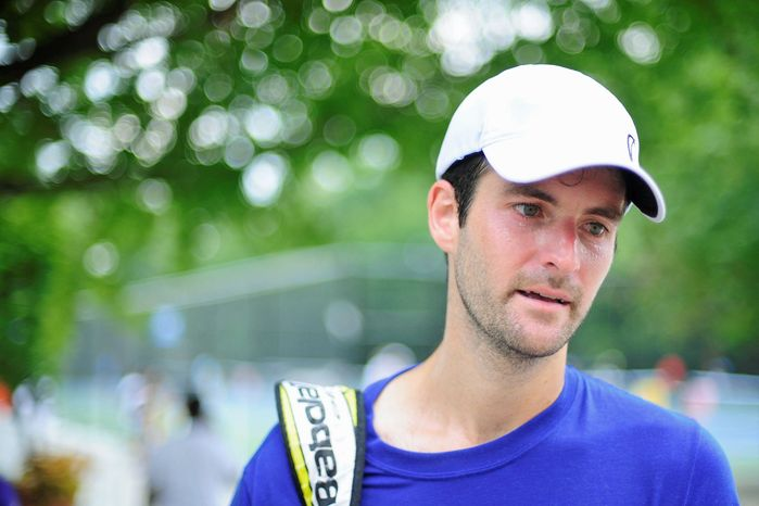 Brian Baker gives an interview following a practice session at the Citi Open tennis tournament, at the William H.G. FitzGerald Tennis Center, Washington D.C., Sunday, July 29, 2012. (Ryan M.L. Young/The Washington Times)