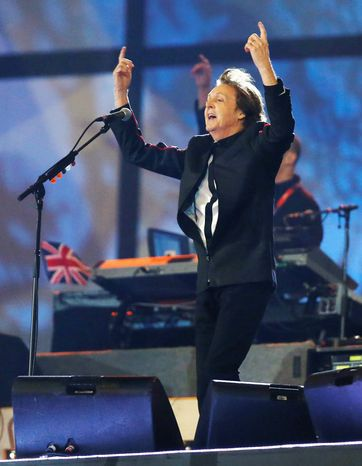 Paul McCartney performs during the opening ceremony of the 2012 Summer Olympics on Saturday, July 28, 2012, in London. (AP Photo/Matt Dunham, Pool)