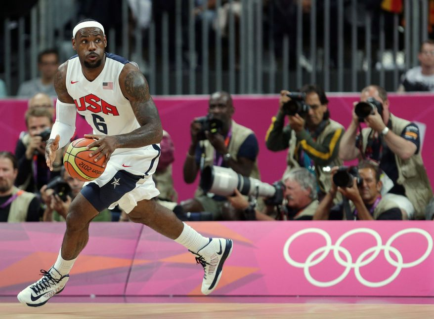 associated press photographs  Lebron James and Carmelo Anthony (below, battling France's Kevin Seraphin) are two of only three U.S. men's basketball players to take part in three Olympic Games. After having minimal playing time for the 2004 squad that took bronze in Athens, they were leaders on the '08 team that won gold in Beijing.