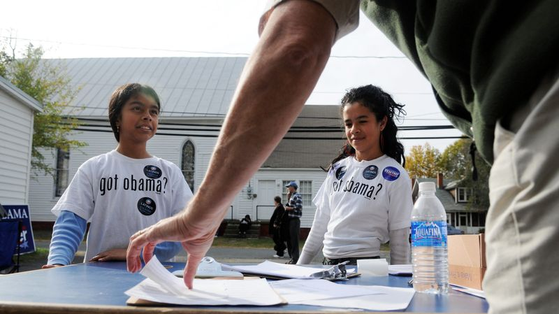 In November 2008, Cassandra Calderon and her sister, Jennifer Calderon, of Manassas volunteered to campaign for Sen. Barack Obama. Dennis Barrow, a volunteer from the District, praises their efforts. Obama supporters came to Virginia to encourage people to vote for Mr. Obama. (The Washington Times)
