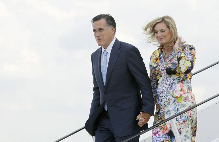 ** FILE ** Mitt Romney, the presumptive Republican nominee, and his wife, Ann, arrive in Gdansk, Poland, on Monday, July 30, 2012. (Associated Press)