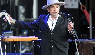 "**FILE** Bob Dylan performs July 22, 2012, on at ""Les Vieilles Charrues"" Festival in Carhaix, France. (Associated Press)"