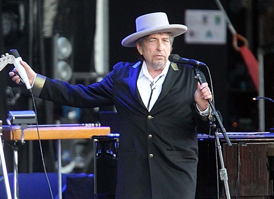 """**FILE** Bob Dylan performs July 22, 2012, on at """"Les Vieilles Charrues"""" Festival in Carhaix, France. (Associated Press)"""