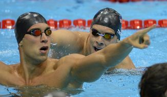 United States' Matthew Grevers, left, and United States' Nick Thoman react after the men's 100-meter backstroke swimming final at the Aquatics Centre in the Olympic Park during the 2012 Summer Olympics in London, Monday, July 30, 2012. Grevers won gold, Thoman silver.  (AP Photo/David J. Phillip)