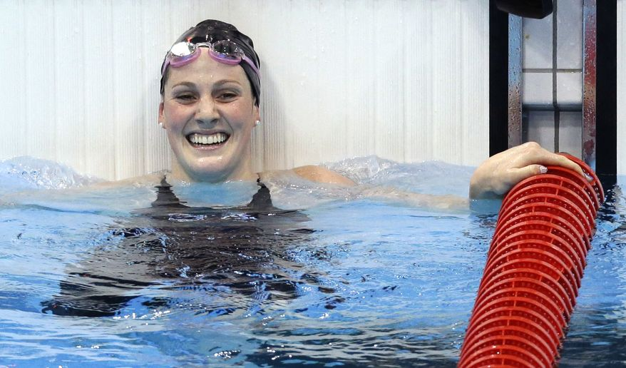 United States' Missy Franklin reacts to her gold nedal win in the women's 100-meter backstroke swimming final at the Aquatics Centre in the Olympic Park during the 2012 Summer Olympics in London, Monday, July 30, 2012. (AP Photo/Lee Jin-man)