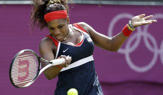 Serena Williams of the United States returns a shot to Urszula Radwanska at the All England Lawn Tennis Club at Wimbledon, in London, at the 2012 Summer Olympics, Monday, July 30, 2012. (AP Photo/Mark Humphrey)
