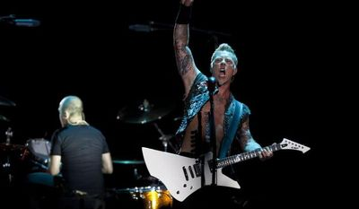 James Hetfield, lead singer for the heavy metal rock band Metallica, performs July 28, 2012, during a concert at the Sports Palace in Mexico City. (Associated Press)