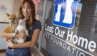 Jodi Polanski, founder and executive director of Lost Our Home Pet Foundation, stands outside her business in Phoenix. Lost Our Home helps people facing foreclosure place their pets with other families or in foster environments until their owners can get them back. (Associated Press)