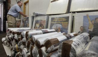 Ira Kramer, nephew of the original Movie Star News founder Irving Klaw, looks over movie posters packed for transport, at the shop in New York on July 25, 2012. Movie Star News, a New York institution since 1939 credited with creating the concept of pin-up art, has been shuttered, and with it nearly 3-million Hollywood-related posters, vintage photographs and original negatives are destined for a different future. (Associated Press)