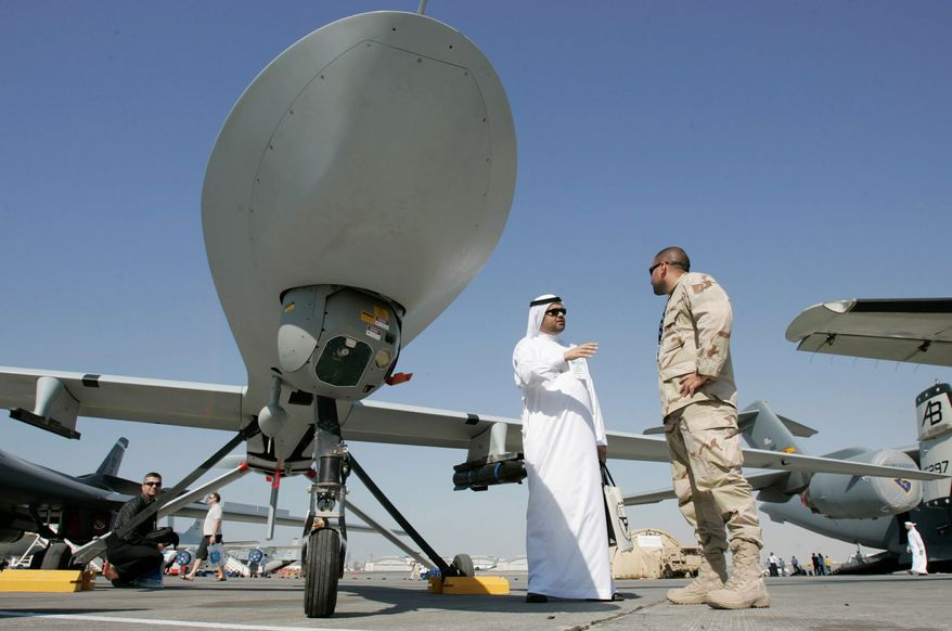 An Emarati and a U.S. military representative talk next to an MQ-1 Predator spy plane at the 2007 Dubai Airshow in the United Arab Emirates. The United States has in the works possible arms deals totaling more than $11.3 billion to Gulf states including Qatar and Kuwait as part of its strategy to contain Iran and protect shipping. (Associated Press)