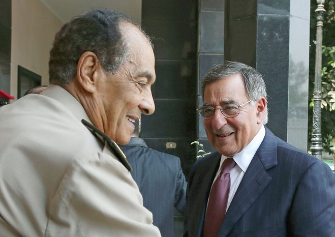 Defense Secretary Leon E. Panetta is greeted Tuesday by Egyptian Defense Minister Mohamed Hussein Tantawi in Cairo. Mr. Panetta also met for the first time with Egyptian President Mohamed Morsi. (Associated Press)