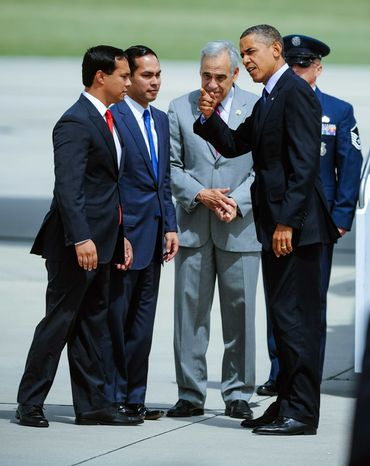 ** FILE ** President Barack Obama's visits with Texas State Rep. Joaquin Castro (D), his twin brother San Antonio Mayor Julian Castro and Congressman Charles Gonzalez, from left, upon his arrival Tuesday, July 17, 2012 in San Antonio. (AP Photo/Bahram Mark Sobhani)