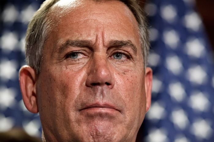 **FILE** House Speaker John Boehner, Ohio Republican, talks July 24, 2012, to reporters following a closed-door political strategy session at the Capitol in Washington. (Associated Press)