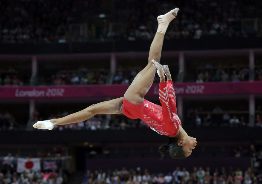 U.S. gymnast Gabrielle Douglas performs July 31, 2012, on the balance beam during the artistic gymnastics women's team final at the 2012 Summer Olympics in London. (Associated Press)