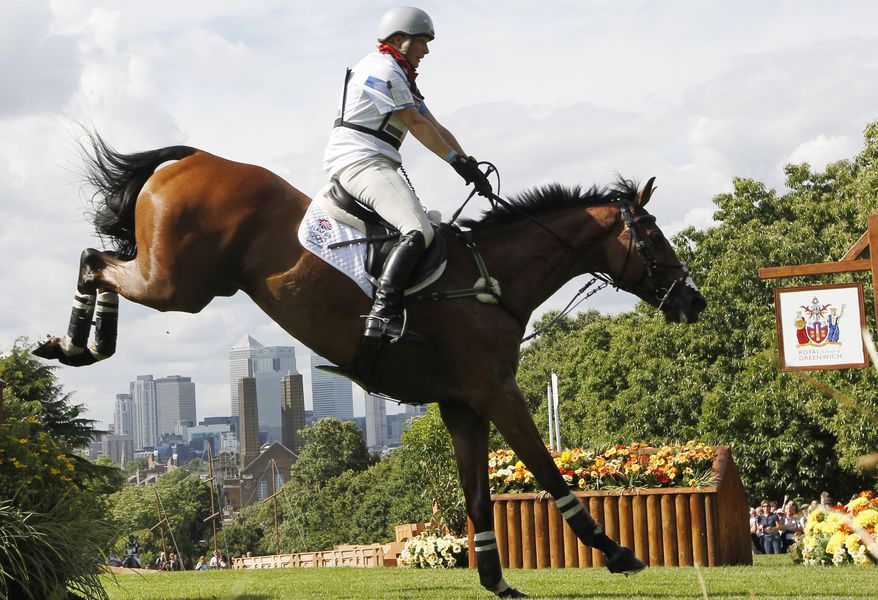 Zara Phillips of Great Britain rides High Kingdom as she competes July 30, 2012, in the equestrian eventing cross-country stage at the 2012 Summer Olympics in London. (Associated Press)