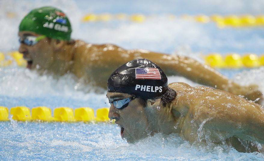 United States swimmer Michael Phelps (front) and South Africa's Chad le Clos compete in the men's 200-meter butterfly swimming final at the Aquatics Centre in the Olympic Park in London during the 2012 Summer Olympics on July 31, 2012. Le Clos won gold, Phelps silver. (Associated Press