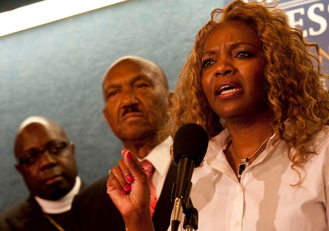 """Presiding Prelate of the Covenant International Fellowship of Churches Bishop Janice Hollis, from Philadelphia, Pa., joins Wiliam Owen, president and founder of the Coalition of African-American Pastors, to launch a national campaign to oppose President Obama's support of gay marriage during a press conference at the National Press Club on Tuesday, July 31, 2012, in Washington D.C. """"He does not have a pass,"""" Hollis says in response to the general belief that President Obama is going to win the majority of the African American vote. The CAAP say they are urging black pastors around the country to oppose the president's actions and withdraw support for him in the upcoming November elections. (Raymond Thompson/The Washington Times)"""