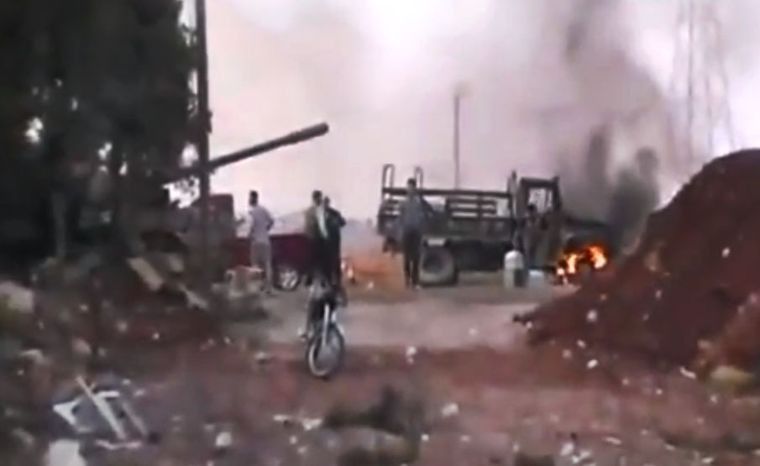 This image made from amateur video released by the Ugarit News and accessed July 30, 2012, purports to show Free Syrian Army soldiers in Anadan 16 kilometers (10 miles) from Aleppo, Syria. (Associated Press/Ugarit News via AP video)