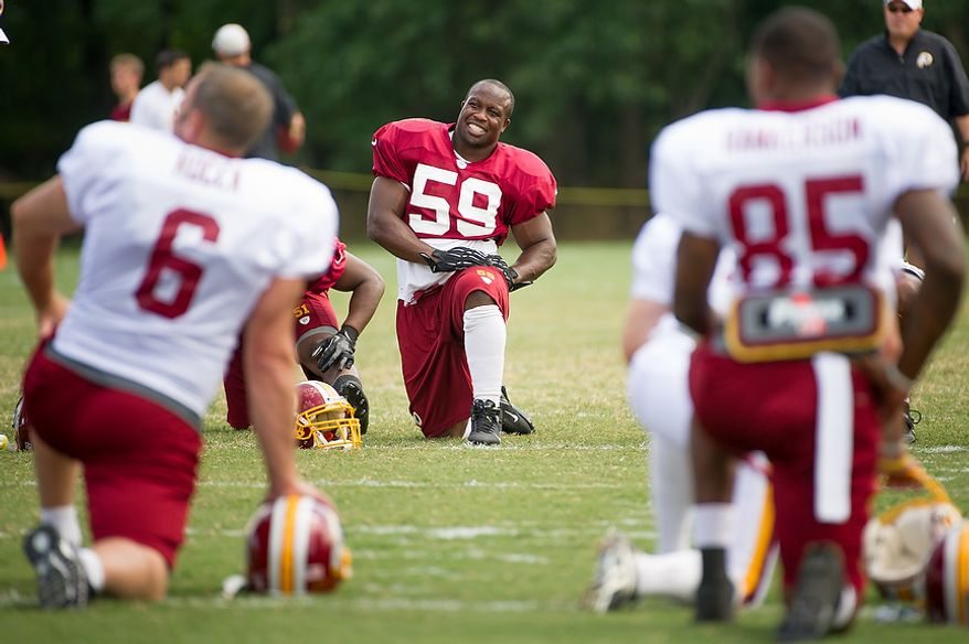 Washington Redskins linebacker London Fletcher (59), center, warms up for afternoon practice at the Washington Redskins training camp at Redskins Park, Ashburn, Va., Washington, D.C., Monday, July 30, 2012. (Andrew Harnik/The Washington Times)