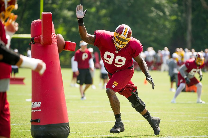 Washington Redskins defensive tackle Jarvis Jenkins (99) runs a drill during afternoon practice at the Washington Redskins training camp at Redskins Park, Ashburn, Va., Washington, D.C., Monday, July 30, 2012. (Andrew Harnik/The Washington Times)