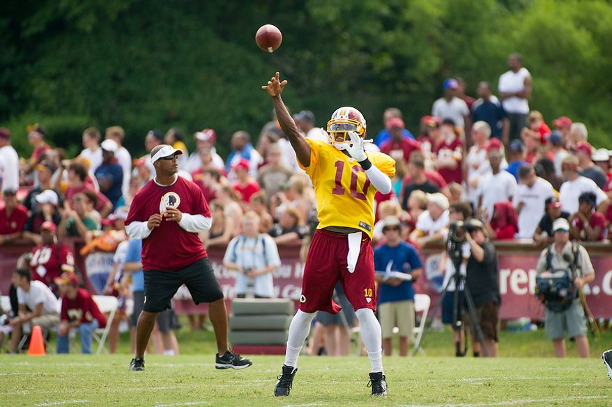 Washington Redskins quarterback Robert Griffin III (10) passes during afternoon practice at the Washington Redskins training camp at Redskins Park, Ashburn, Va., Washington, D.C., Monday, July 30, 2012. (Andrew Harnik/The Washington Times)
