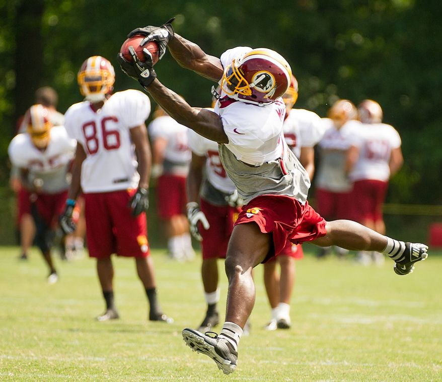 Washington Redskins wide receiver Josh Morgan (15) catches a pass during afternoon practice at the Washington Redskins training camp at Redskins Park, Ashburn, Va., Washington, D.C., Monday, July 30, 2012. (Andrew Harnik/The Washington Times)