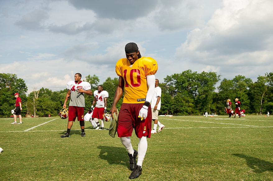 Washington Redskins quarterback Robert Griffin III (10) leaves the field following afternoon practice at the Washington Redskins training camp at Redskins Park, Ashburn, Va., Washington, D.C., Monday, July 30, 2012. (Andrew Harnik/The Washington Times)