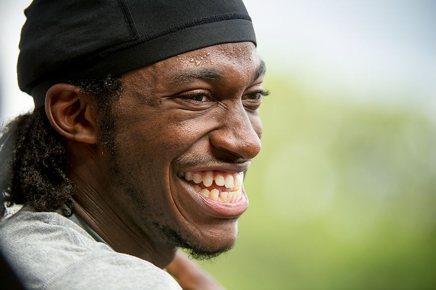 Washington Redskins quarterback Robert Griffin III (10) speaks to reporters following afternoon practice at the Washington Redskins training camp at Redskins Park, Ashburn, Va., Washington, D.C., Monday, July 30, 2012. (Andrew Harnik/The Washington Times)
