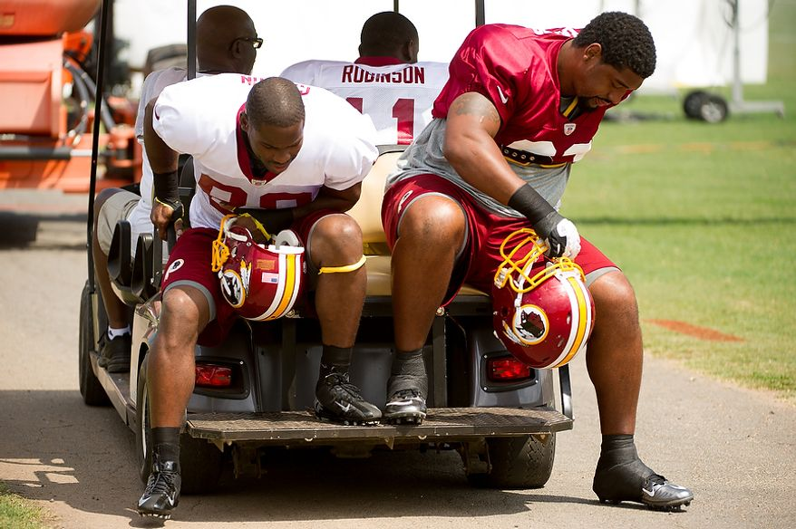 Washington Redskins wide receiver Pierre Garcon (88), left, and Washington Redskins defensive end Kentwan Balmer (93) arrives for afternoon practice at training camp at Redskins Park, Ashburn, Va., Washington, D.C., Monday, July 30, 2012. (Andrew Harnik/The Washington Times)