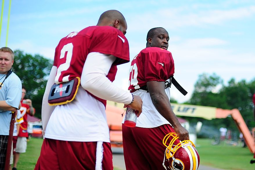 London Fletcher (#59) takes the field during Redskins' training camp at Redskins Park, Ashburn, Va., Monday, July 30, 2012.  (Ryan M.L. Young/The Washington Times)