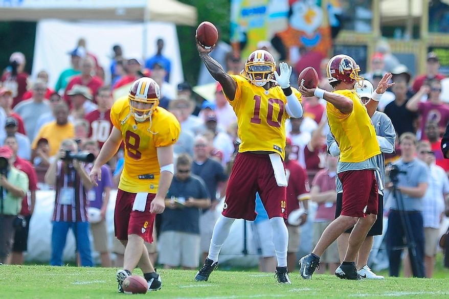 Robert Griffin III (#10), center, Rex Grossman (#8), left, and Jonathan Crompton (#3), right, participate in drills during Redskins' training camp at Redskins Park, Ashburn, Va., Monday, July 30, 2012.  (Ryan M.L. Young/The Washington Times)