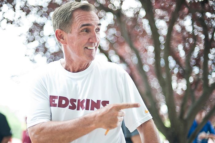 Redskins coach Mike Shanahan jokes with Robert Griffin III (not pictured) while going to meet members of the press following Redskins' training camp at Redskins Park, Ashburn, Va., Monday, July 30, 2012.  (Ryan M.L. Young/The Washington Times)